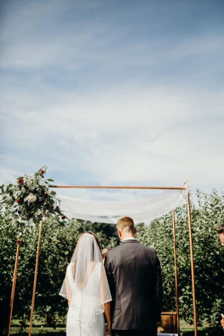 outdoor wedding venues copper arch wedding ceremony