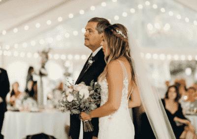 father escorts bride